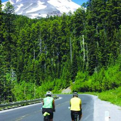 Cyclists enjoy riding on the smooth roads in the shadow of Mt. Hood