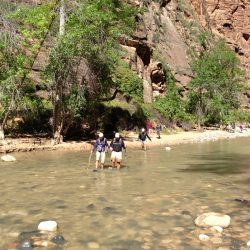 people in a river canyon