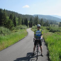 Biker smiles on a bike path in Vail, Colorado