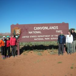 People in front of Canyon sign