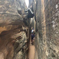 hiking through a skinny canyon