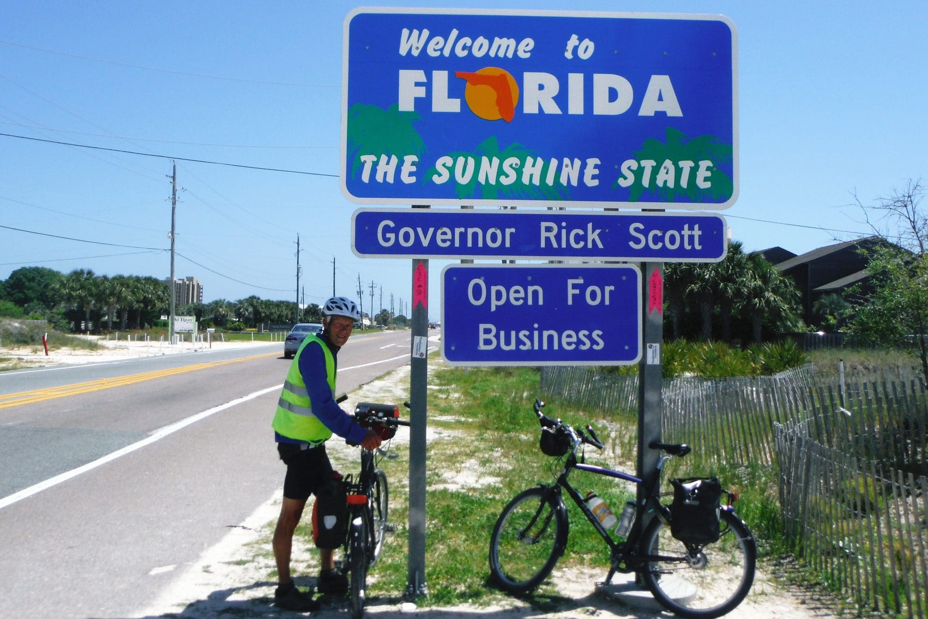 Bikers in front of the Florida State sign