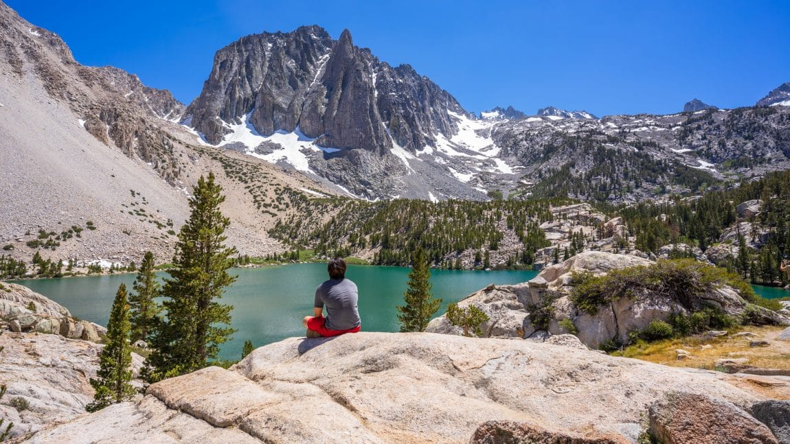 Hiker overlooking the mountains and lake