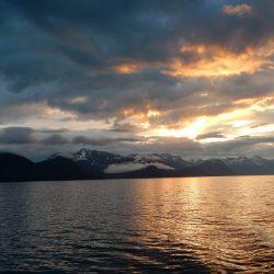Sunset over Alaska bay and glaciers