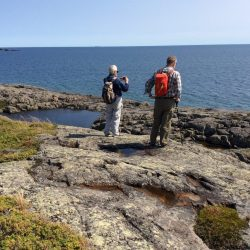 Two hikers overlook Lake Superior in Isle Royale National Park