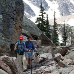 Two hikers on the rocky mountains