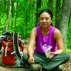 Hiker woman eating a snack