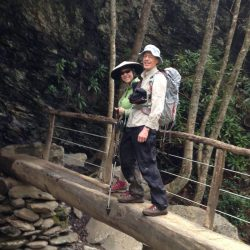 hikers on a log