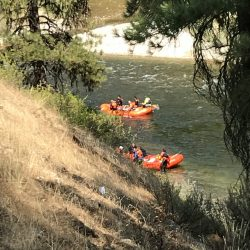 Two rafts full of people in a river