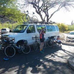 white van and biker
