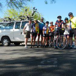group of bikers outside of a van