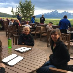 Two women on a tour sit at a table in Grand Teton National Park
