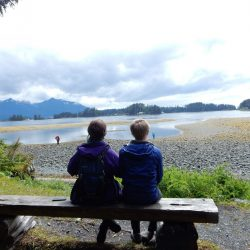 couple sit on a bench in Alaska