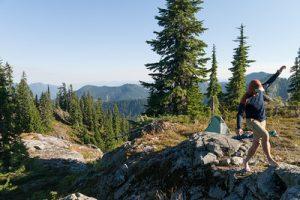 hiker balancing on rock