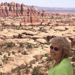 Woman smiling in front of a canyon