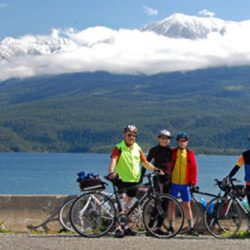 Bikers in front of a lake in the Selkirk - Kootenay Mountains
