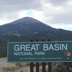 Great Basin National Park sign in front of mountain peak