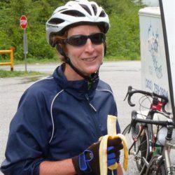 Biker smiles for photo on bike tour