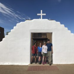 Hikers in front of a religious landmark