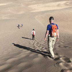 Hikers on sand dunes in Santa Fe