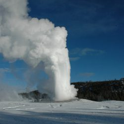 Old Faithful eruption in winter Yellowstone National Park